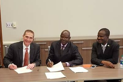 AAUA VC,Prof. Igbekele Ajibefun signing an MoU with the President of Auburn University, Alabama, USA, with them is Prof. Henry Fadamiro and Ondo State Head of Service, Barr. Toyin Akinkuotu in Alabama, last week.