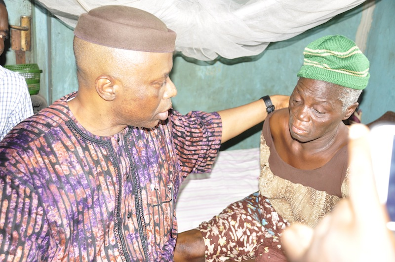 Ondo State Governor, Dr Olusegun Mimiko ( left), with mother of the deceased, Madam Ige (right) during the Governor's visit to the family of the deceased, in Akure,