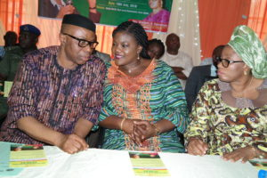 From left; Ondo State Governor, Dr Olusegun Mimiko, his wife, Olukemi, and Commissioner for Women Affairs, Olasimi Akindele-Odunbaku, at the official inauguration of the Ondo State food palliative programme (Eto Igbe Ayo), in Ikare-Akoko, on Tuesday.