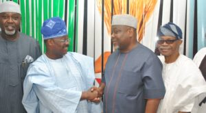 The National Organising Secretary of the All Progressives Congress (APC), Senator Osita Izunaso (third right) in a warm handshake with the Chairman Screening Committee for the 2016 Ondo State governorship election primaries, Oyo State Governor Abiola Ajimobi. They are flanked by the APC National Auditor, Chief George Moghalu (left) and APC National Vice-chairman (Southwest) Chief Pius Akinyelure (right).