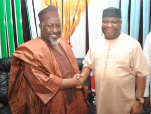 The National Organising Secretary of the All Progressives Congress (APC), Senator Osita Izunaso (right) in a handshake with the Jigawa State Governor and Chairman of the 2016 Ondo State APC Governorship Election Primary Committee, Muhammadu Badaru Abubakar
