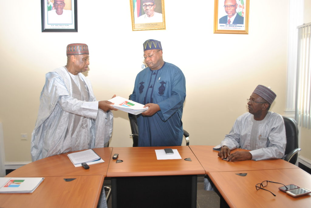 The All Progressives Congress (APC) National Vice Chairman (North West), Inuwa Abdul-Kadir (right) receiving the report of the four-member fact finding committee chaired by Senator Mohammed Magoro (left) which was set up by the APC National Leadership to look into the leadership dispute in the Kano state chapter of the Party. The Deputy National Chairman (North), Senator Lawal Shuaibu (right) looks on.