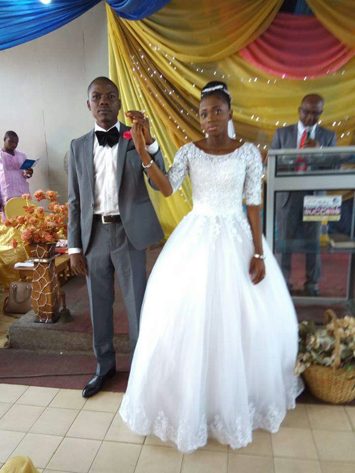 Abimbola walks down the aisle with her Beau , Abisoye Olatunde Jolaosho.