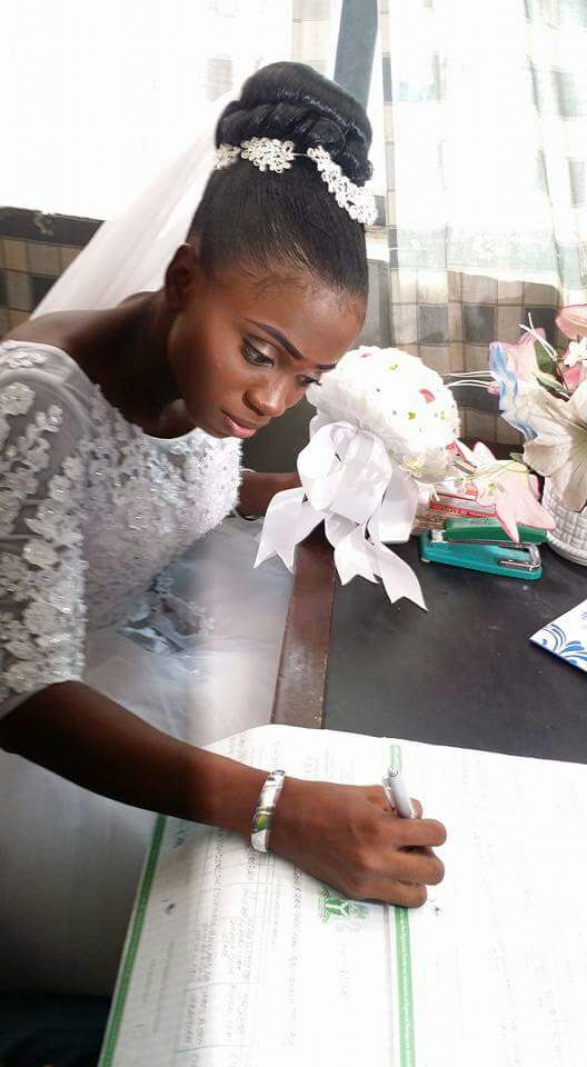 The bride signing the dotted line.
