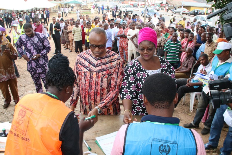 PHOTOS:  Ondo State Governor, Dr Olusegun Mimiko and his wife, Olukemi, being accredited at unit 20, Ward 7, in Ondo town, during Ondo Governorship election