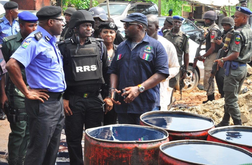 Lagos State Police Commissioner, Mr. Fatai Owoseni; with Commander, Rapid Response Squad (RRS), ACP Tunji Disu and Permanent Secretary, Lands Bureau, Lagos State Governor's Office, Mr. Bode Agoro during the arrest of Operators of an illegal Oil Depot in Oregun, Onigbongbo LCDA