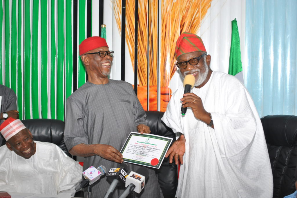 National Chairman of the All Progressives Congress (APC), Chief John Odigie-Oyegun (Left) displaying INEC's Certificate of Return presented to Ondo State Governor-elect, Oluwarotimi Akeredolu (Right) when the latter paid a thank you visit to the APC National Secretariat on Wednesday evening. Kano State Governor, Dr. Abdullahi Umar Ganduje looks on.